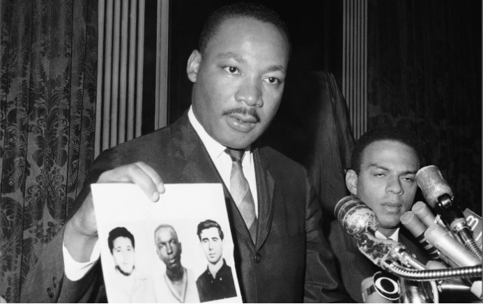 Martin Luther King Jr Holding Picture Of Murders Activists